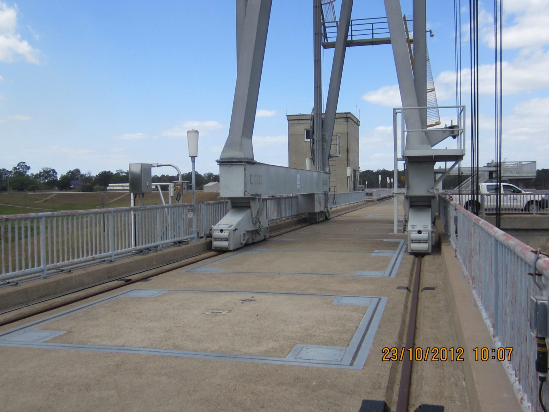 Bridge over the radial gates and one of the local control cubicles